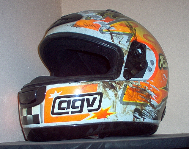 Smashed and bloody motorcycle helmet