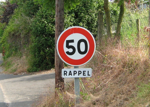 a french speed limits sign, the number 50 in a red circle
