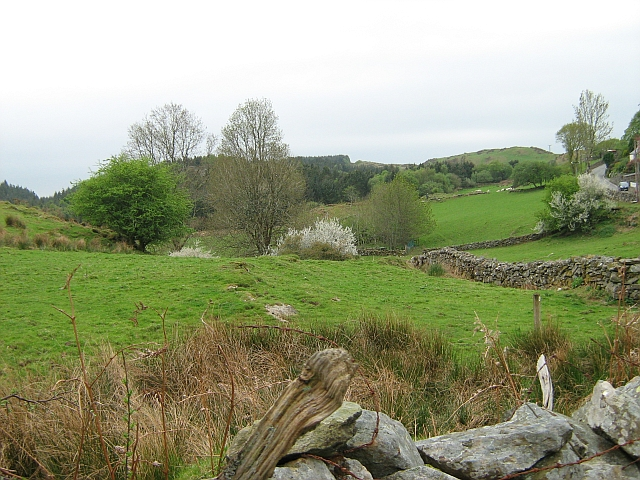 Green hills, rocky outcrops and trees, a typical welsh countryside scene