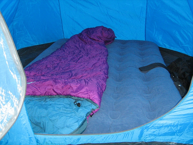 the inside of the sleeping area in my tent, complete with sleeping bag and air bed