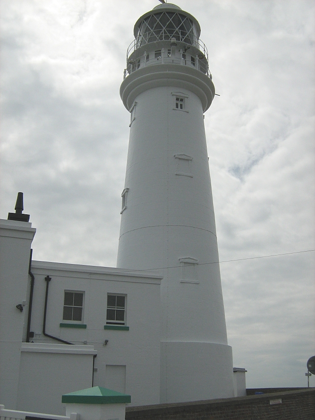 Flamborough head lighthouse set against a grey sky
