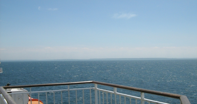 looking over to france in the distance from the ferry out at sea