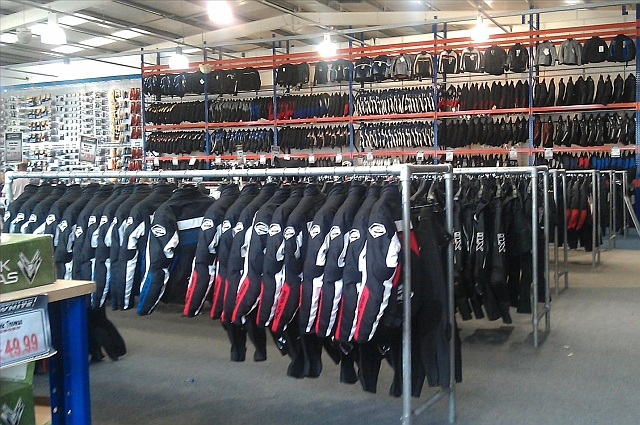 the inside of george whites showing a big shop with racks full of bike jackets and motorcycle clothing
