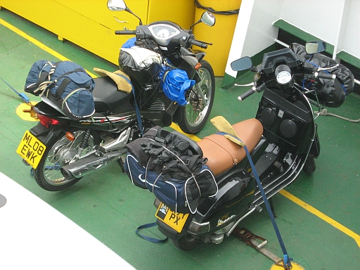 Honda Innova 125 and Vespa 200, loaded with camping gear on the ferry