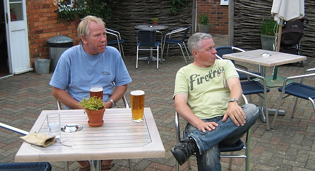 iw and sl sat at a table in the beer garden snettisham
