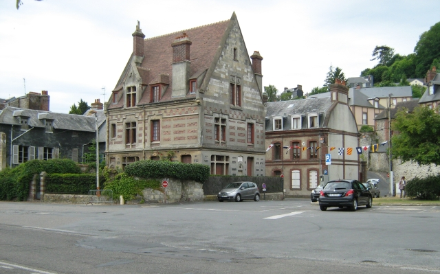 a large french style house on a broad street
