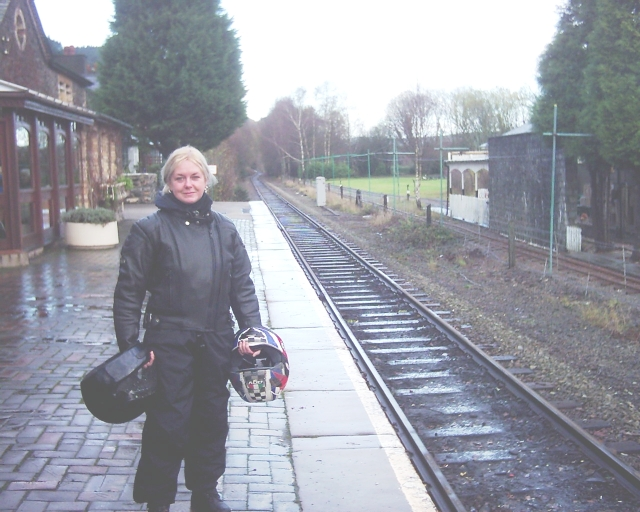 the gf in full wet weather riding gear at betws-y-coed train station