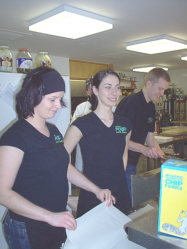 nice girls serving food at a cafe