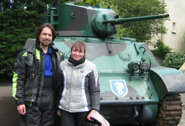 the editor and his girlfriend stood next to a small tank at the grand bunker