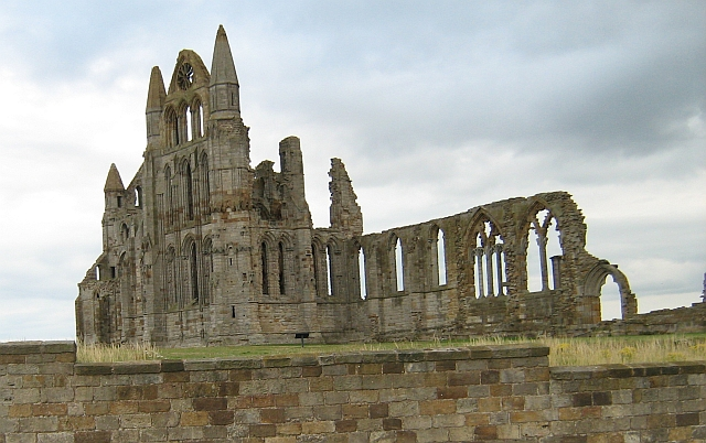 The ruins of Whitby Abbey, set against a grey sky