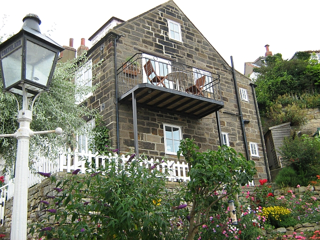 Stone built cottage with a veranda in Runswick Bay