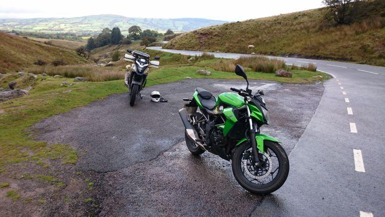 Ren and Sharon's motorcycles set against the rugged moors and hills of the Brecon Beacons