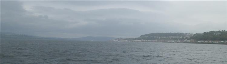 The clyde estuary, massive broad stretch of water between very wet and misty mountains