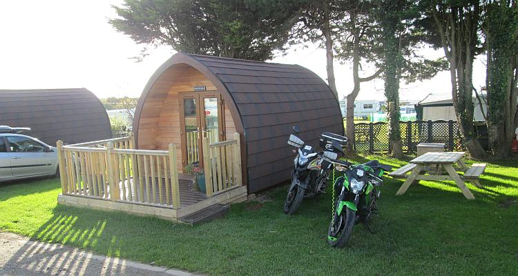 The camping pod and the bikes in the morning sun