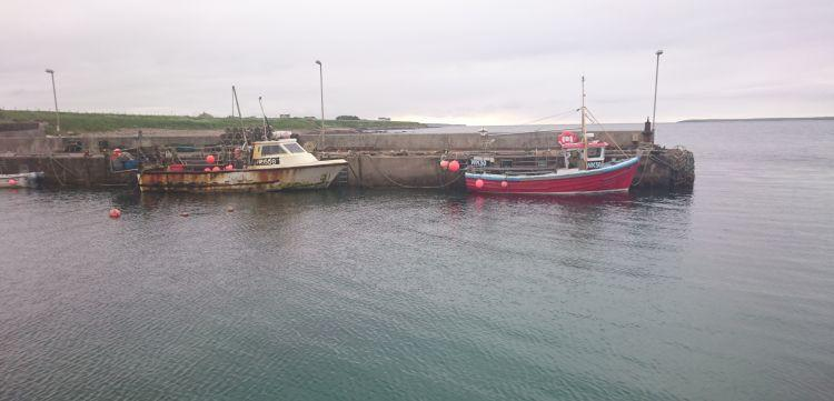 2 old small fishing boat at the harbour in John O'Groats