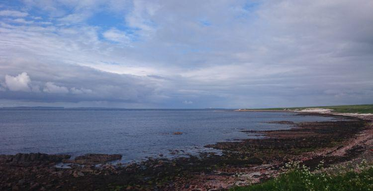 A stony and remote beach at John O'Groats