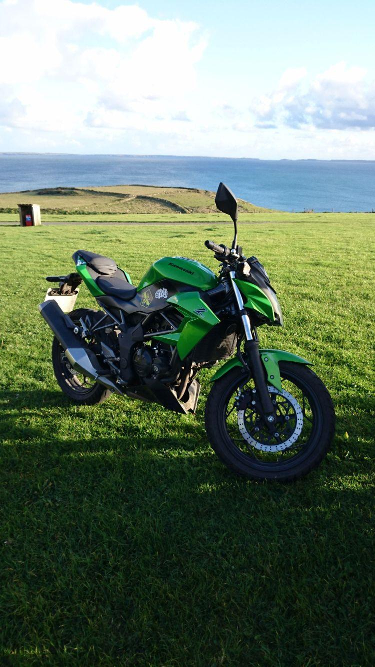 Sharon's 250 with gorgeous wide fields, sea, skies and beauty behind it
