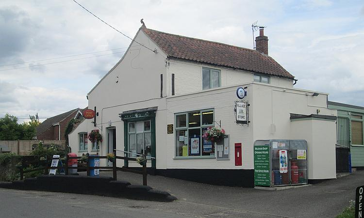 The shop in Mileham, a white building in a rural village in Norfolk
