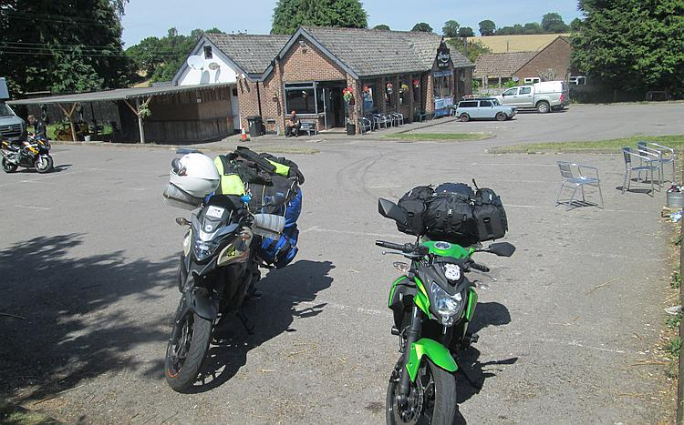Ren and Sharon's motorcycles outside Loomies biker cafe in glorious hot sunshine
