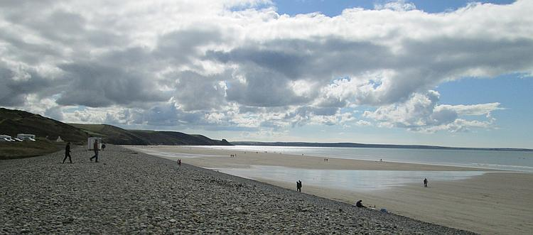 Vast broad sandy beach, a stone coastal defence and hills at Newgale Beach