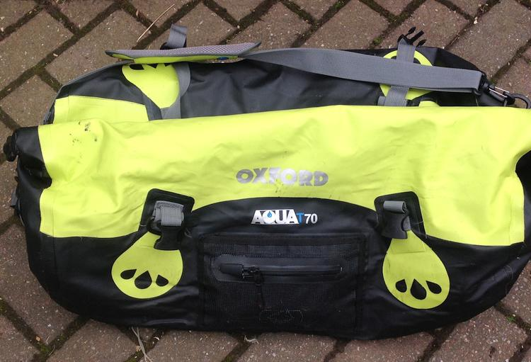 The large bright yellow Oxford roll bag complete with handles and straps