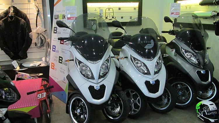 The Piaggio MP3 looks like a big scooter but with 2 front wheels