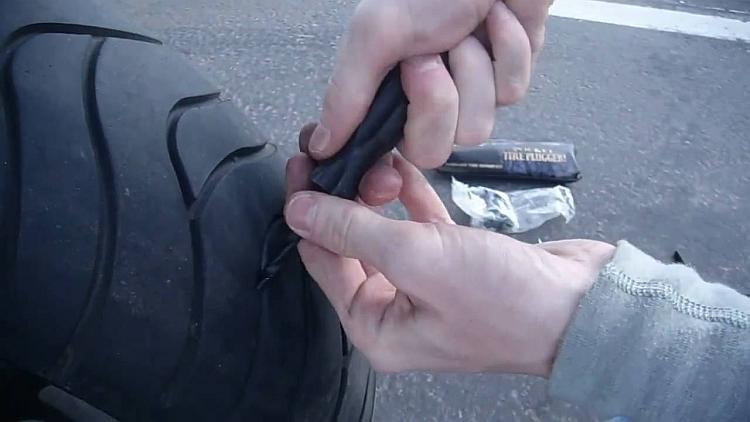 The reaming tool is forced into the hole made by whatever caused the puncture