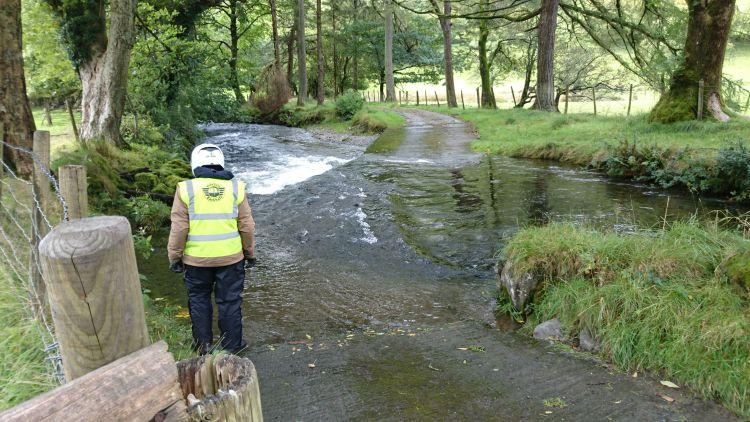 Ren stands considering the fast flowing ford in front of him deep in the countryside