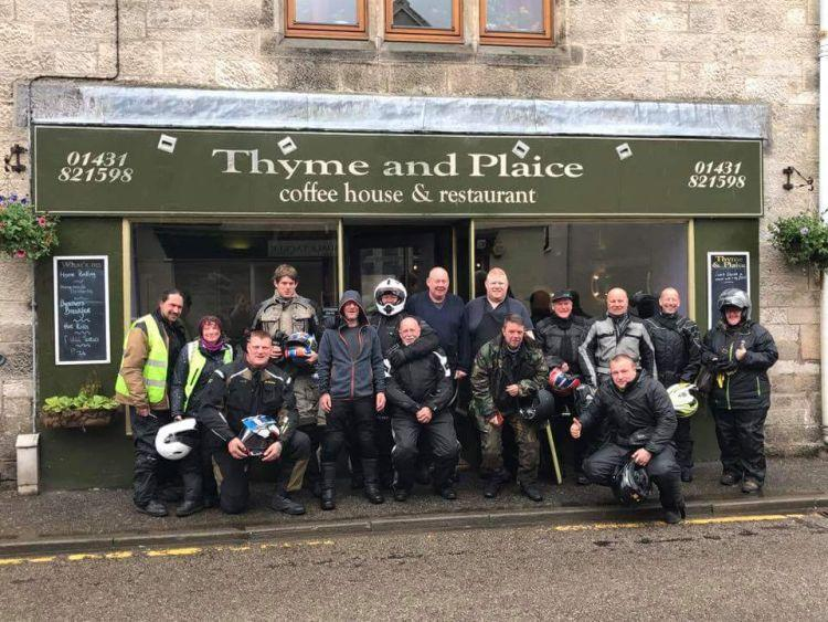 The bunch of bikers riding the NC500 outside the cafe in Helmsdale