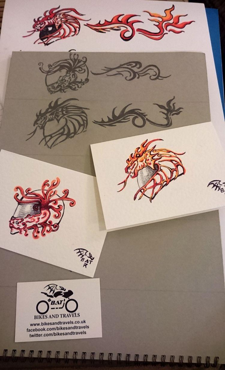 Various drawings of simple helmets with dragons and flames coming off them