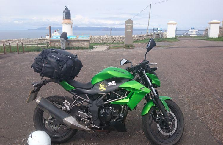 Sharon's famous Kawasaki Z250SL with luggage at Dunnet Head Lighthouse