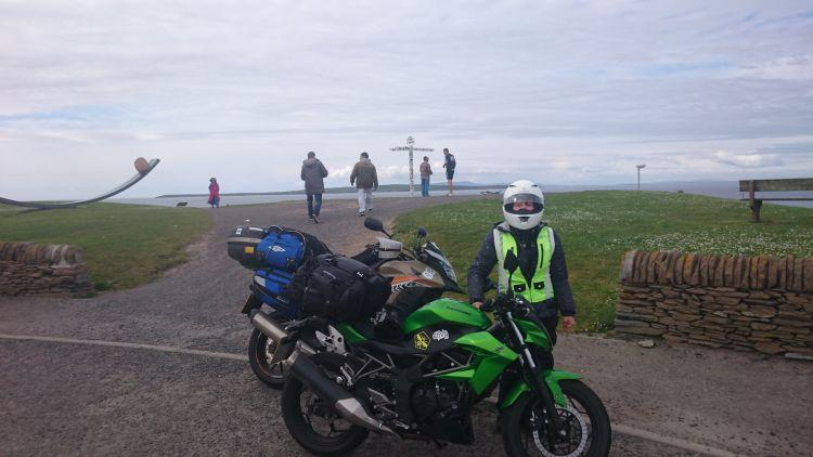 Sharon stands by her Z250SL at the John O'Groats signpost