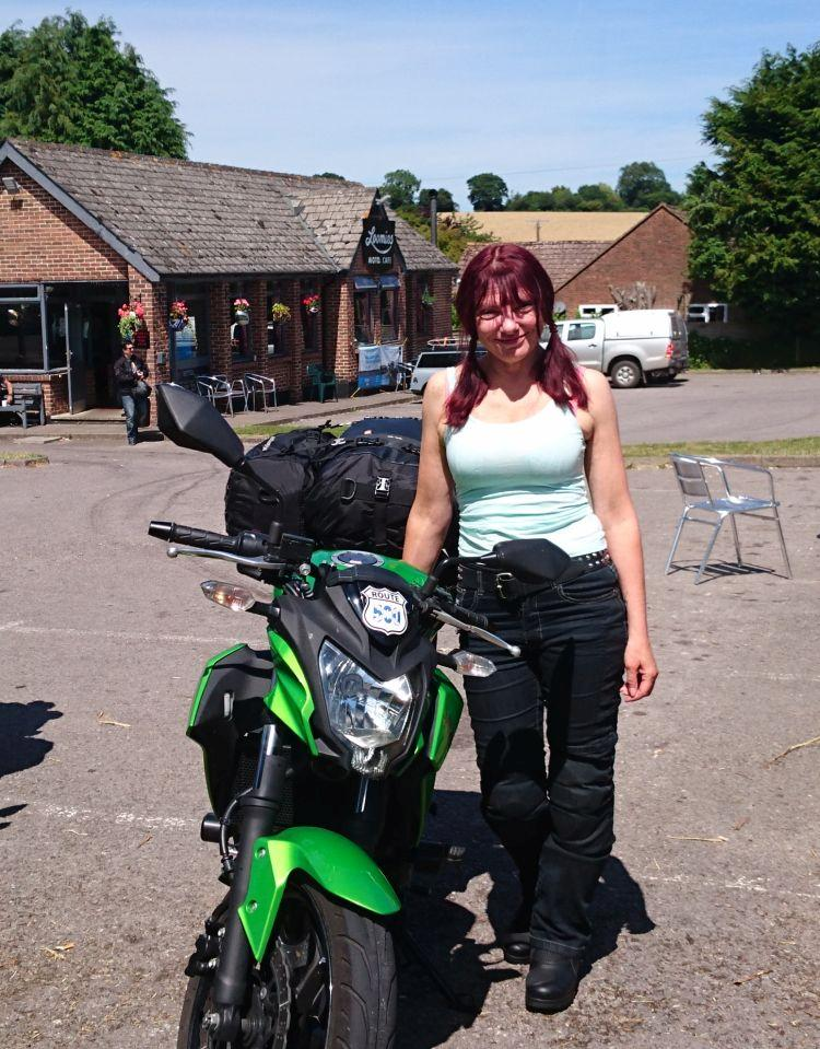 Sharon poses next to her bike wearing her snug fitting motorcycle jeans