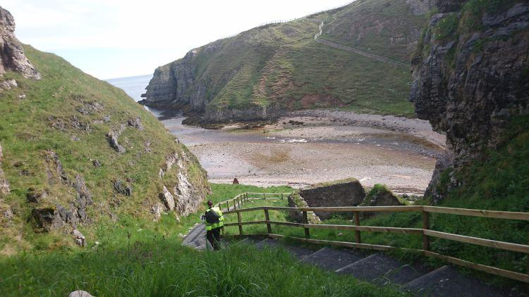The steep steps cut into the side of the cove leading to Smoo Cave