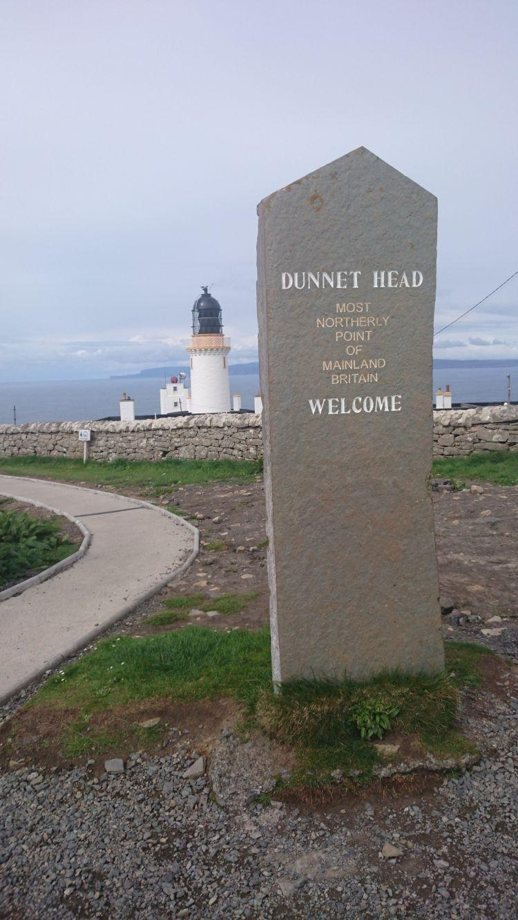 A smart clean stone with writing carved into it telling us we're at Dunnet Head