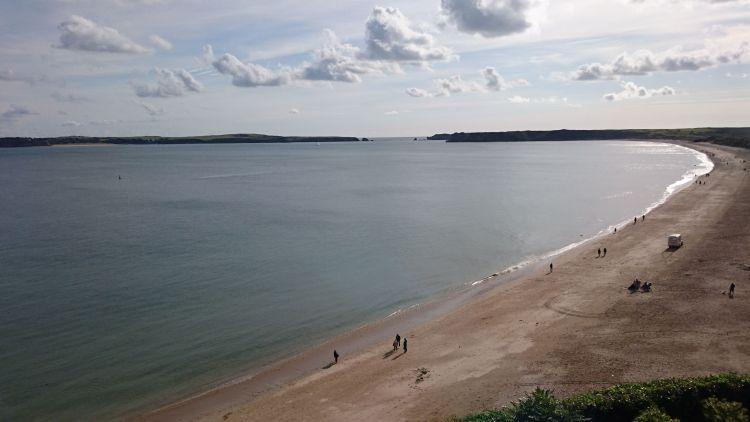 The broad and long beach at Tenby seen from the cliffs above