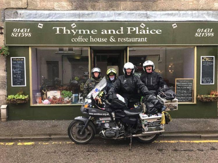 4 of the motorcyclists stood outside the cafe with Bernard's BMW