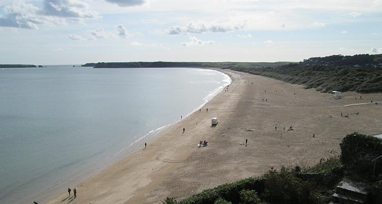 The massive long beach at Tenby covered in golden sand