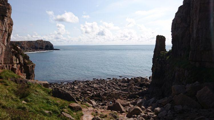 Looking out from the chapel we see a rocky shoreline, cliffs and towering rocks