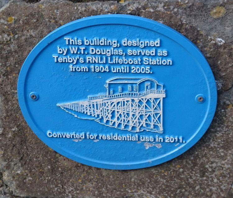 A blue commemorative place recording the creator of the lifeboat station and it's change to a dwelling
