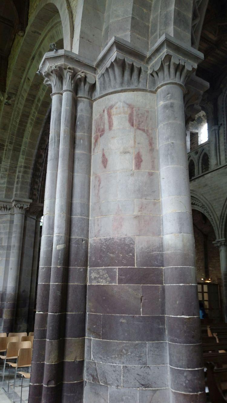 The outline of a knight is seen faintly on a massive column in the cathedral