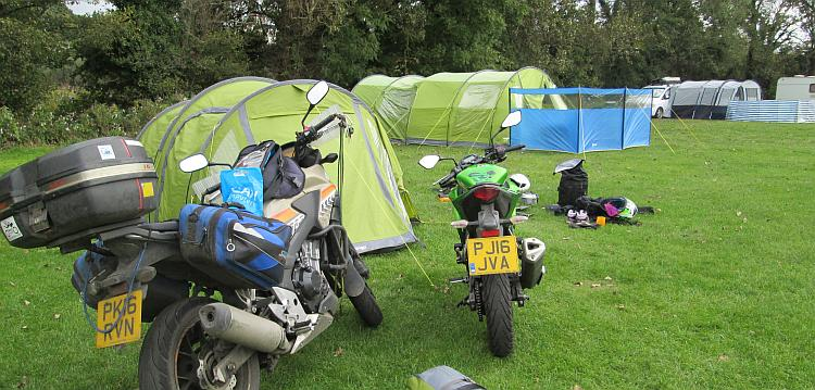 The 2 motorcycles and the tent and kit at the campsite at Kiln Park, Tenby