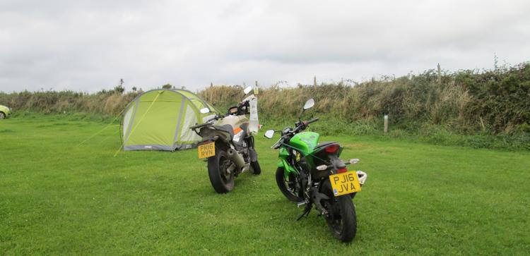 The motorcycles next to the tent, they're staying put today