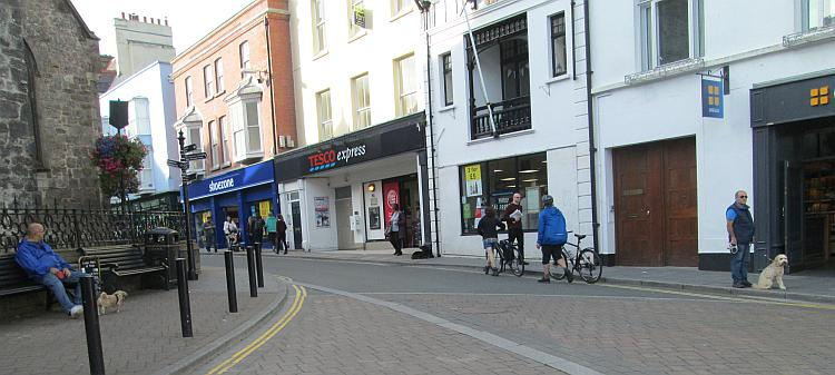 A Tesco and shoe shop squeezed into old buildings in Tenby town centre