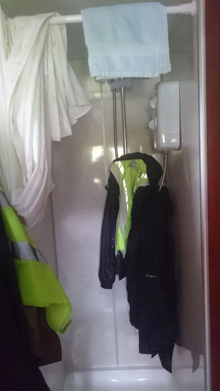 The small but great shower in the carriage at Sleeperzzz, our bike gear is hanging up drying