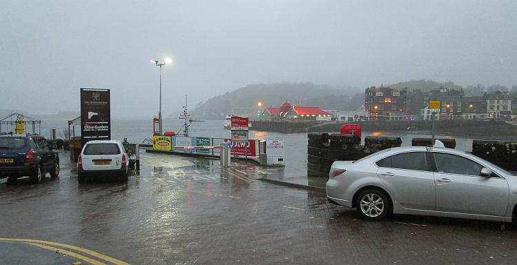 Oban harbour on a cold wet and windy early evening in winter