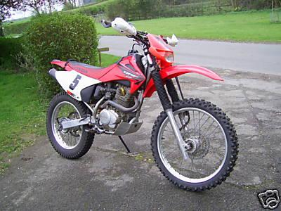 Bill's bright red CRF230 Honda