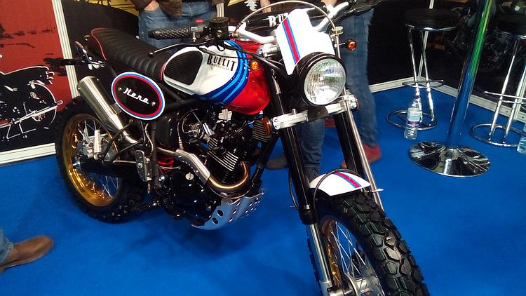 A Bullit Scrambler motorcycle. Retro styling but long travel suspension in a new bike