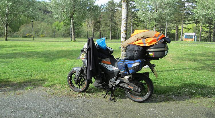 Ren's Honda CB500X full loaded with all the camping and travel gear at the campsite near Burgos