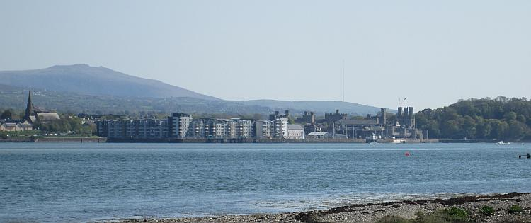 Across the Menai Strait we can see the town and castle of Caernarfon